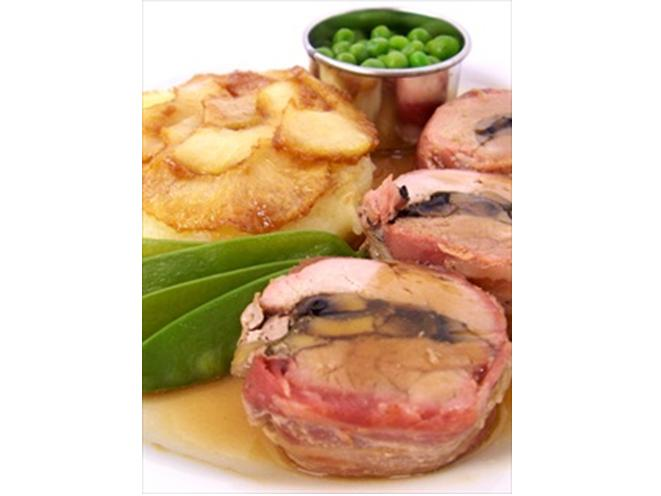 Roast Pork Tenderloin, layered with Mushroom & Sage Stuffing, wrapped in Smoked Streaky Bacon, served with Caramelised Apples on a Potato Cake with Garden Peas and White Wine Gravy